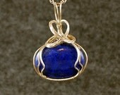Small oval dark blue Lapis, sterling silver heart wire wrap - P139
