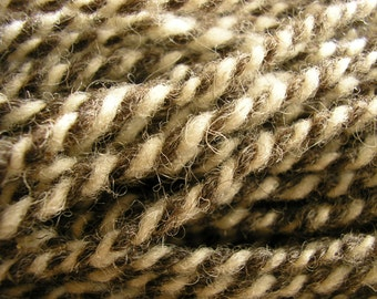 Twist handspun wool yarn, in cream and gray, two ply, 4.2 ounces of worsted weight yarn