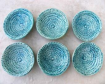 Textured turquoise ceramic bowl