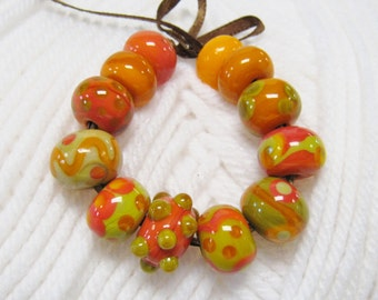 Earth Tone Handmade Lampwork Beads: Autumn Colors of Orange, Green, Relish  and Stone Ground and Tomato Soup.