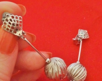 "1960s Vintage 2.25"" silver tone dangle style earrings  in great condition"