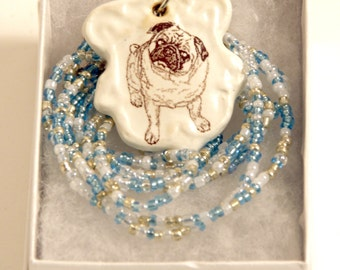 Fawn Pug Pendant Stoneware with pale blue, clear and white Beaded Necklace