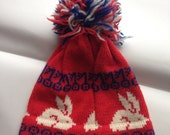 Steamboat Springs Colorado Hat .Rabbit motif .pom pom 1970s into 1980s .Deep Powder Designs