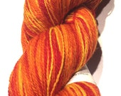 Aade long Artistic (Kauni) 100% wool, 222g (7.83oz) 2 ply yarn in red-yellow- orange colors, self-striping, long smooth changeover