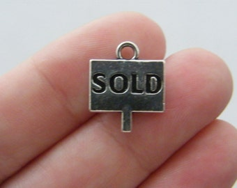 4 Sold charms antique silver tone P130