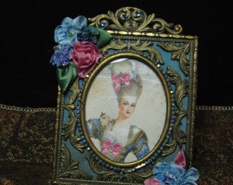 Marie Antoinette vintage brass frame with a picture of her done in blues and bling