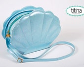 the mermaid sea shell bag in iridescent pastel blue