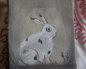 Primitive small painting of a spotted rabbit early style canvas on wood.