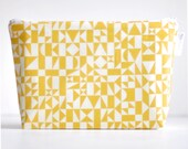 cosmetic bag. large wet bag. sunshine yellow geo. organic cotton. by Cloud Love Baby