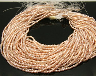 2strands - orange purple  fresh water pearl rondel 3.5mm