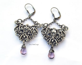Handcrafted Wire Wrapped Earrings in Sterling Silver And Amethyst.