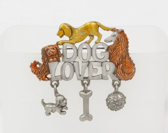 Vintage Dog Lover Brooch, Pewter with a Pekenese Collie and Basset Hound, Dangling toys from the bottom of the letters Dog bone, Dog ball