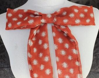 Cute chiffon bow  dark orange   color with polka dot  print
