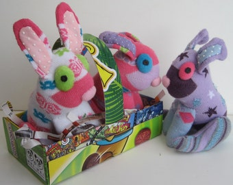BUNNTOWN ABBEY are 3 sock sisters Mary, Edith and Sybil child safe Easter bunnies . A parody of BBC's Downton Abbey .