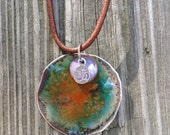 Yoga necklace with silver OM charm orange and blue enamel