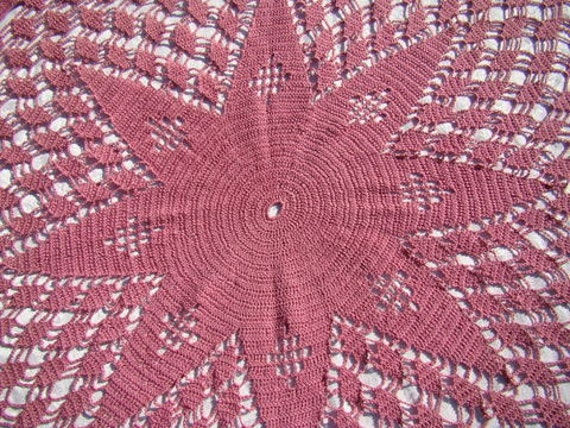 Hand crocheted dusty rose starburst table cloth