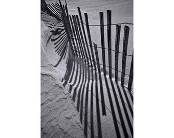 Snow Fence in Winter on the Lake Michigan Beach by Grand Haven State Park in Michigan No.0165 A Black and White Abstract Landscape Photo