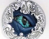 Sightmares Custom Eye Necklace in Silver Case with Blue Eye