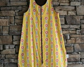 6-12 month sleepsack in yellow and brown with pink flowers