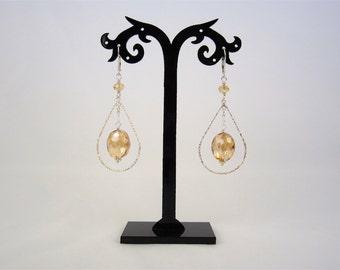 Sterling silver teardrop chandelier earrings with Light Topaz colored crystal earrings. EJGT-M4