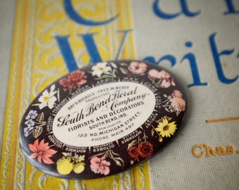 Antique celluloid advertising mirror, Cruver Manufacturing Co, South Bend Floral Company, Indiana, pocket mirror, 1910s, calendar of flowers
