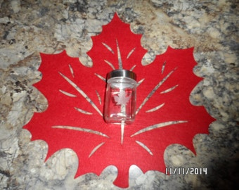 Small Glass lidded jar etched with a leaf.