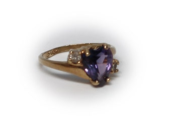 Petite Heart Shaped Amethyst 10K Yellow Gold Ring diagonally embellished by two Diamonds