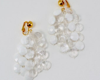 Vintage Goldtone Opaque Clear White Plastic Faceted Bead Cascading Chandelier Gold Tone Cha Cha Cluster Clip On Dangle Earrings