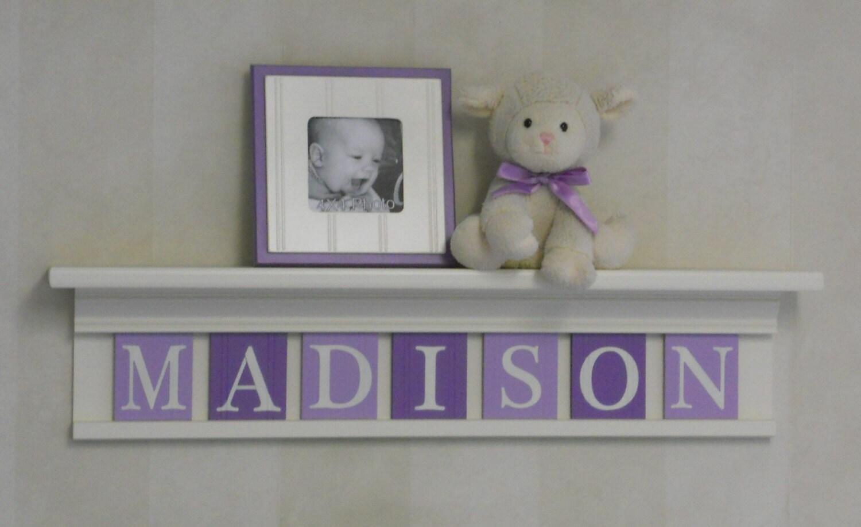 Purple baby girl nursery decor white or off white shelf with - Baby girl nursery ideas purple ...
