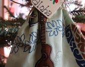Hawaiian angel, Anela, ornament, Ukulele and tapa design, green