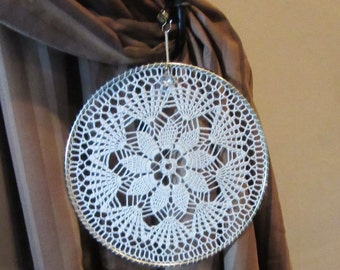 9 inch Delicate eye-catching crochet window or wall hanging with a small crystal