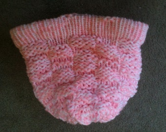 Knitted peach and white hat