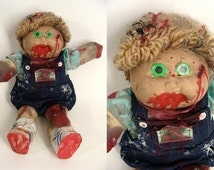Bloody Zombie Doll. Creepy Doll. with Glow In The Dark Eyes upcycled Cabbage Patch Kid BOY Halloween Costume Accessory Haunted House Prop