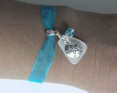 Beach glass bracelet with Sand dollar. Sea glass jewelry. Sand dollar bracelet.