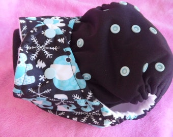 SassyCloth one size pocket diaper with elephants and snowflakes PUL print and black PUL front. Made to order.