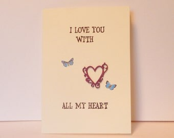 Valentines Day greeting card with blue butterflies and a wooden heart  saying I Love You with all my Heart