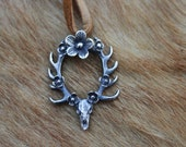 Floral Deerly Departed Necklace. Sterling silver deer skull antler pendant with flowers.