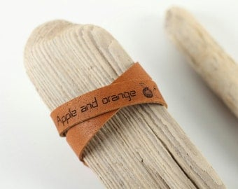 "Wrist band leather bracelet engraved ""Apple and Orange"". Handmade engraved cuff bracelet by WildGood gift idea Him or Her"