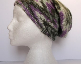 Unisex. Semi camouflage hand knitted slouchy beanie in  self patterning wool. Adult or teenager.