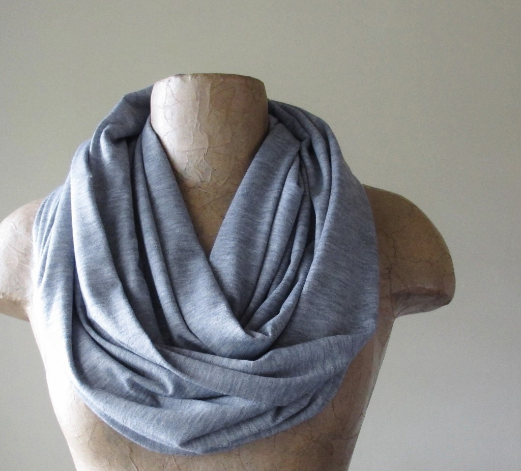 Grey Infinity Scarf - This grey infinity scarf was passed down to me by a friend, so I'm not sure how much it was worn. What I do know though is that it's in amazing condition! There are a few loose strands here and there but nothing that's completely falling off. It is very beautiful and a great accent to any outfit! The tag is a little cut off, but I do believe that it says that the.