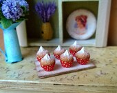 1/12 scale miniature dollhouse red polka dot cupcakes on the board.