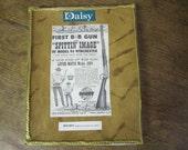 "Unique Daisy Mounted ""Spittin' Image"" advertisement.  Leather, Rope, Mounted Advertisement. Folk Art"