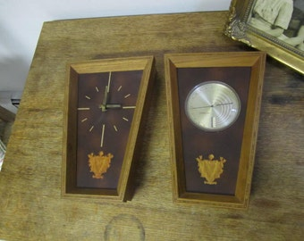 Pair of Mid Century Clock and Thermometer / Hygrometer and Barometer in wood frame. German clock workings.