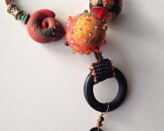 Long necklace mix of polymer clay, beaded felt , paper mache, vintage key.