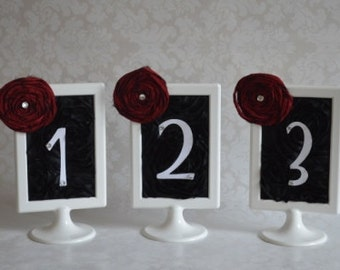 Red, black and White table number