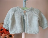 Handmade baby sweater ...........pale mint cardigan with 'flower' button