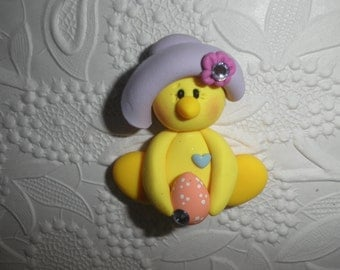 Polymer Clay Easter Chick With Bonnet and Holding a Decorated Easter Egg Bow Center/Pin/Magnet