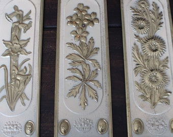 rare MIDCENTURY floral wall plaques made in ENGLAND brass set of 3 collectable ART shabby chic eclectic