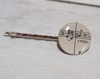 Hair accessory with Beethoven 9th Symphony musical notes (bobby pin).  Made using an original book score (1955).