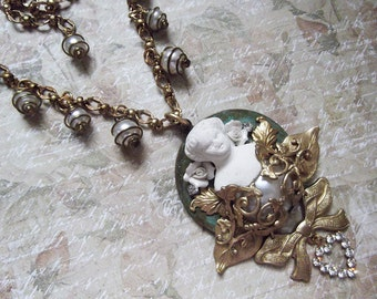 Antique Doll, Charlotte, Porcelain Flower, Faux Pearl Cabochon, Rhinestone heart, Caged Vintage Pearls and Brass Necklace